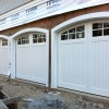 Custom wood garage doors with custom arches