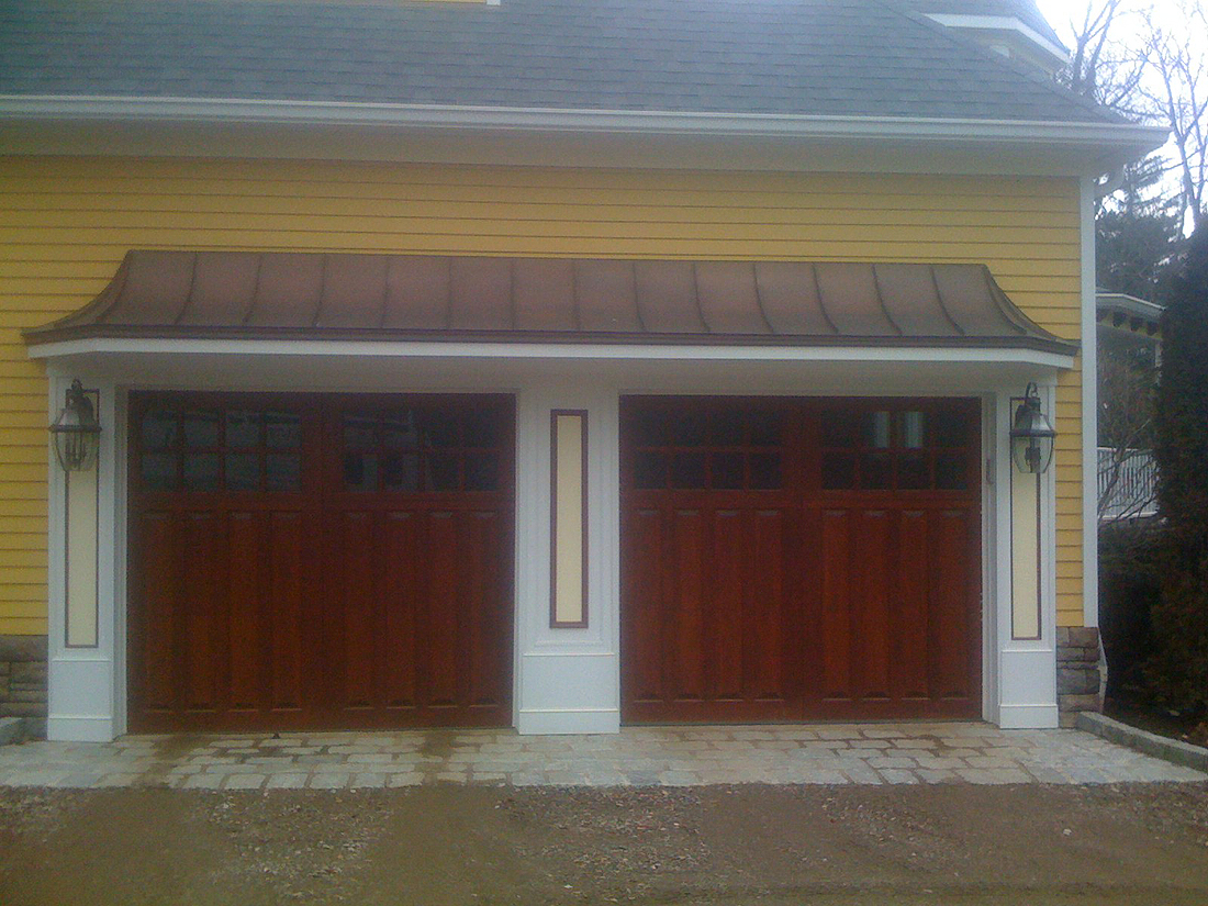 raised panel garage doors with copper_roof