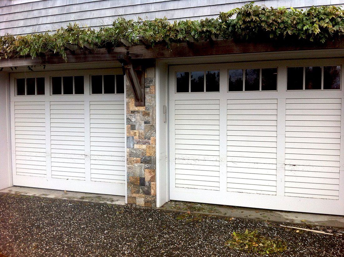 Ultra custom wood shutter type door aj garage door for Wood doors and shutters