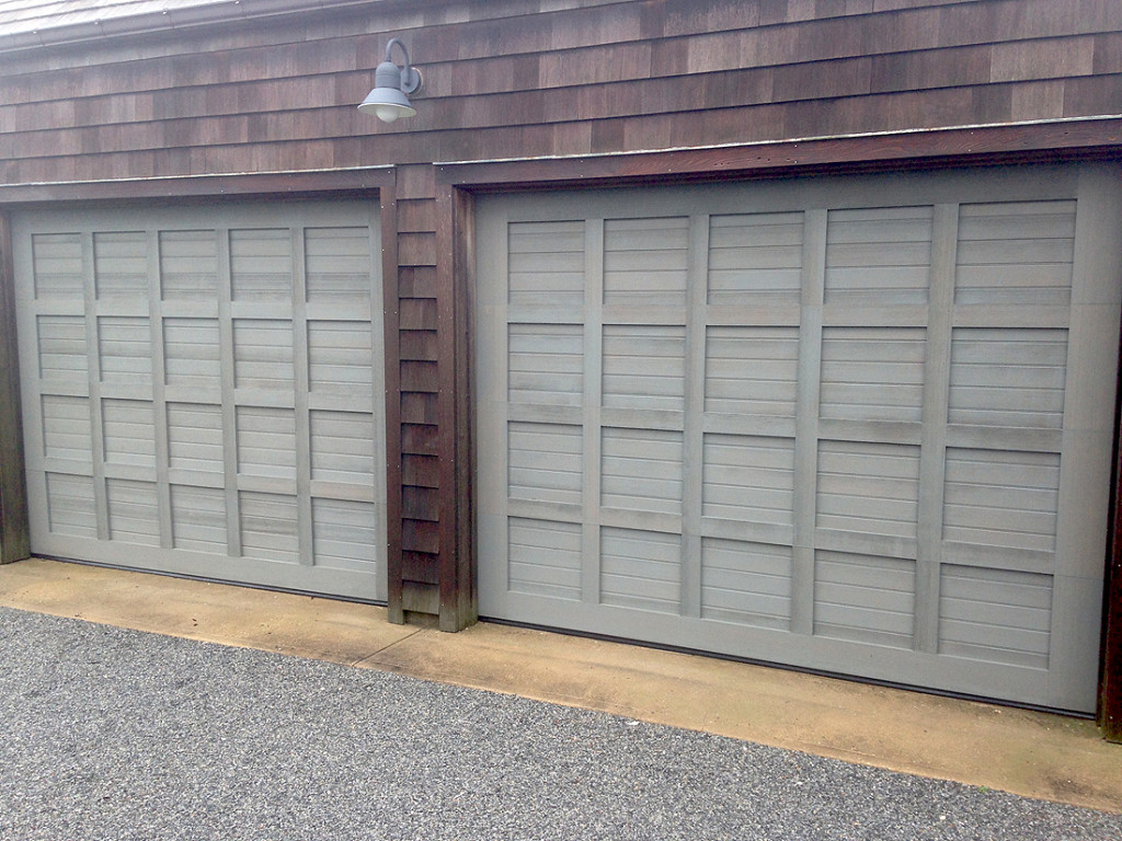 Custom wood garage door with antiquing process on wood surface